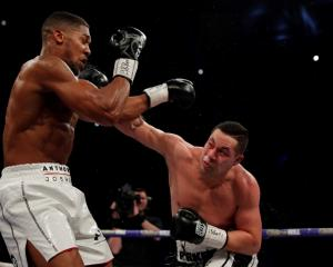 Joseph Parker (R) lands a punch on Anthony Joshua during their bout in Cardiff. Photo: Reuters