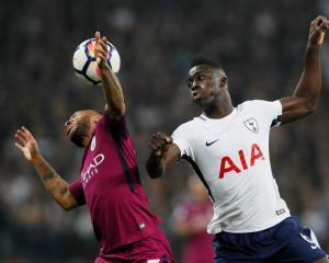 Manchester City's Raheem Sterling (L) vies for the ball with Tottenham's Davinson Sanchez. Photo:...