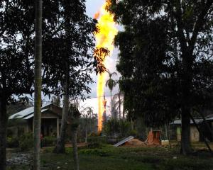 The well burns at a village in Ranto Peureulak, Aceh Province. Photo: Reuters
