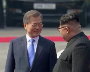 South Korean President Moon Jae-in (L) and North Korean leader Kim Jong Un at a welcome ceremony...