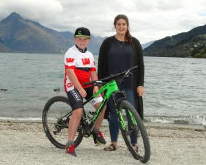 Samuel Muir (11), pictured with teacher Emma Heslin, is cycling the Otago Central Rail Trail for...