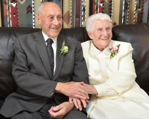 Patrick and Iris Aughterlony share a quiet moment during their 70th wedding anniversary...