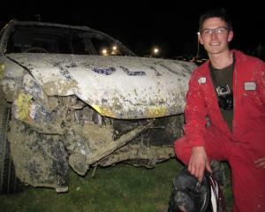 Wanaka racegoer Patrick Rietveld inspects his worse-for-wear car after winning the demolition...