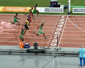 Akani Simbine celebrates as he wins the 100m gold at the Commonwealth Games on the Gold Coast....