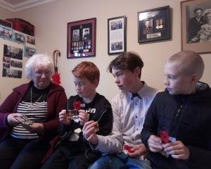 Elsie Herriott discusses the significance of ANZAC Day with three of her Great Grandsons.