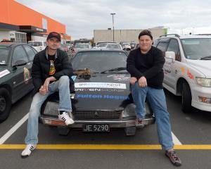 Taranaki men Pete Littlewood (left) and Sven Hanne straddle their 1978 Citroen in Dunedin...