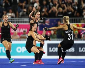 Black Sticks' players celebrate as Stacey Michelsen seals the win in last night's semifinal...