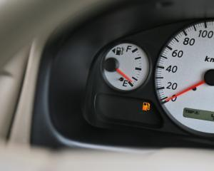 A pre-vehicle inspection was carried out before the driving exam and the low fuel was not noted....