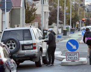 A cyclist takes a detour to avoid a four-wheel-drive vehicle parked in the southbound cycle lane...