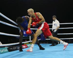 David Nyika deliveres a heavy punch to Yakita Aska at the Commonwealth Games. Photo: Getty Images