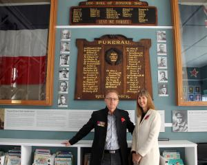 Relative of Sergeant Dick Travis, David MacDonald, and his wife Diane, in front of the Dick...