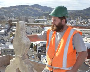 Seventh-generation stonemason Sam Dooley, of Oamaru, checks one of 12 mirrors placed on four...