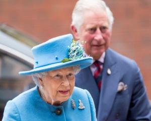 Queen Elizabeth II and Prince Charles, make an official visit to the Household Cavalry Mounted...