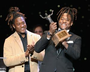 Shaquem Griffin with his identical twin brother Shaquill celebrates at an awards function this...