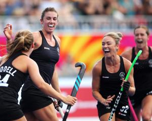 Brooke Neal of New Zealand celebrates scoring a goal during the Pool B Hockey match between New...