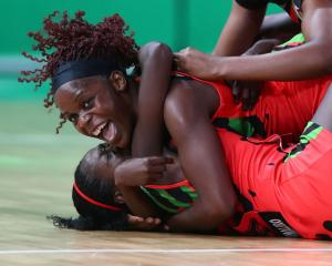 Malawi players celebrate their win over the Silver Ferns. Photo: Getty