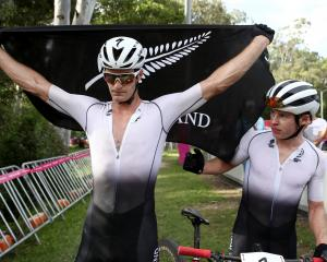 Samuel Gaze (L) and Anton Cooper of New Zealand following the Mens Mountain Bike. Photo: Getty...
