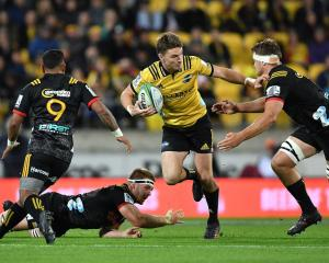 Beauden Barrett runs the ball up for the Hurricanes against the Chiefs. Photo: Getty