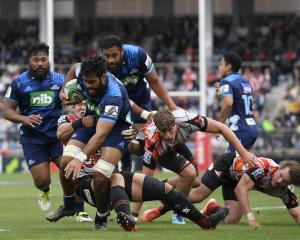 Akira Ioane runs with the ball during during the Super Rugby match between the Sunwolves and the...