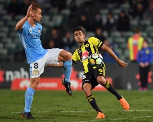 The Phoenix' Sarpreet Singh (R) contests the ball with Melbourne's Oliver Bozanic. Photo Getty...