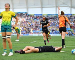 New Zealander Kelly Brazier scores the winning try in the Women's Gold Medal Match between...