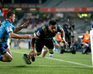 Shannon Frizell scores the second of his three tries for the Highlanders against the Blues...