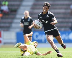 Gayle Broughton of New Zealand makes a break and scores a try during the Cup semi-final between...