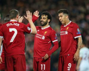 Mohamed Salah celebrates a goal with team mates during Liverpool's 5-2 win in the first leg of...