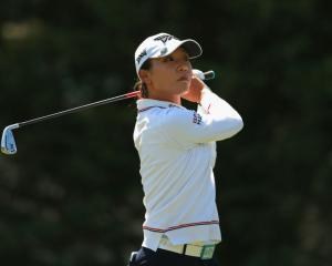 Lydia Ko watches her tee shot on the third hole during the final round. Photo Getty