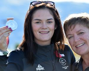 Para-javelin thrower Holly Robinson holds her Commonwealth Games silver medal yesterday alongside...
