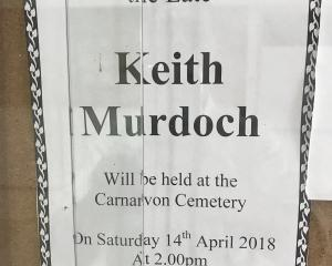 A note advising of a graveside service for Keith Murdoch. PHOTO: SUPPLIED