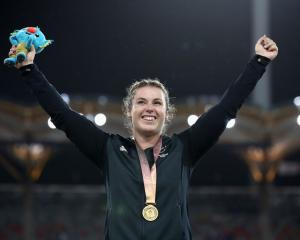 Julia Ratcliffe celebrates on the podium after receiving her gold medal. Photo: Getty Images