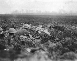 New Zealand troops lie in wait in a machine-gun post on the Somme during the Spring Offensive in...