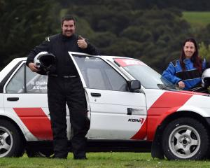 Dunedin driver Richie Chadwick and his co-driver, Alison Glover, stand by the 1985 Toyota...