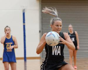 Southern Magpies wing attack Zoey Flockton catches the ball as Phys Ed B goal attack Caitlin...