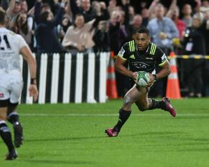 Ngani Laumape of the Hurricanes scores the match winning try during a game against the Sharks....