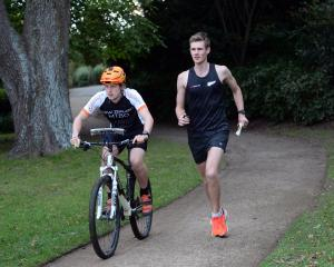 Tom Spencer (21, left) and Alistair Richardson (24) train in the Dunedin Botanic Garden yesterday...