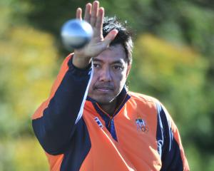 Kant Petchaboon throws a ball during a break in a coaching clinic he held at the Dunedin City...