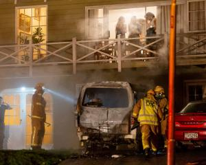Firefighters put out a fire in a van in Queenstown early yesterday. Photo: James Allan Photography