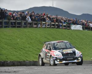 The Suzuki Swift AP4 of Emma Gilmour and Antony McLoughlin in action on special stage 9 in Ward...