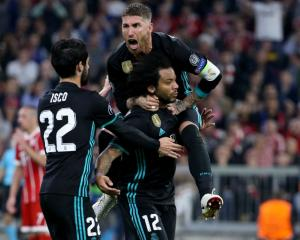 Sergio Ramos climbs on goal scorer Marcelo, as Isco also joins in on the celebrations of Real...