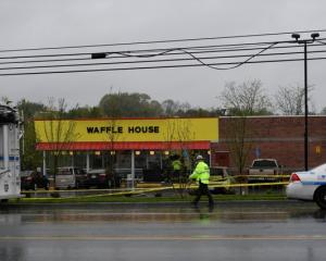 Metro Davidson County Police at the scene of a fatal shooting at a Waffle House restaurant near...