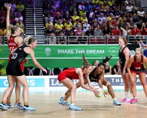 Temalisi Fakahokotau fights with Helen Housby for the ball during the Silver Ferns' match against...