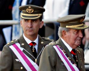 Spain's Crown Prince Felipe with his father King Juan Carlos. REUTERS/Sergio Perez
