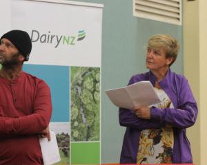 Shane and Eileen Walker look over their farm information while talking at the once-a-day seminar...