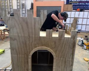 Gray Brothers Builders apprentice Sam Paris, of Shiel Hill, builds a children's castle to win a...