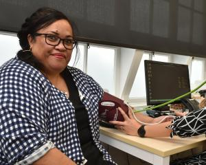 Te Kaika health hub patient Sitoga Tuia has her blood pressure taken by clinic GP Susan Francis...