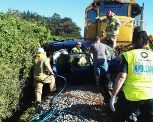 Emergency services at the scene after the train hit the car on Saturday. Photo: Supplied