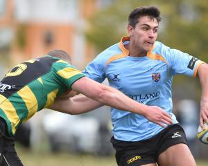 Green Island fullback Alex Barnsley tackles University winger Cam Gerlach during their Dunedin...