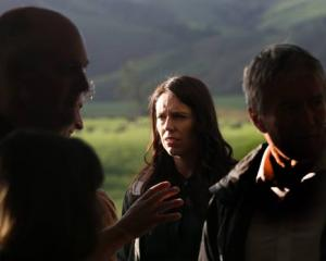 Prime Minister Jacinda Ardern meets farmers on a property near Te Awamutu this morning. Photo: NZ...